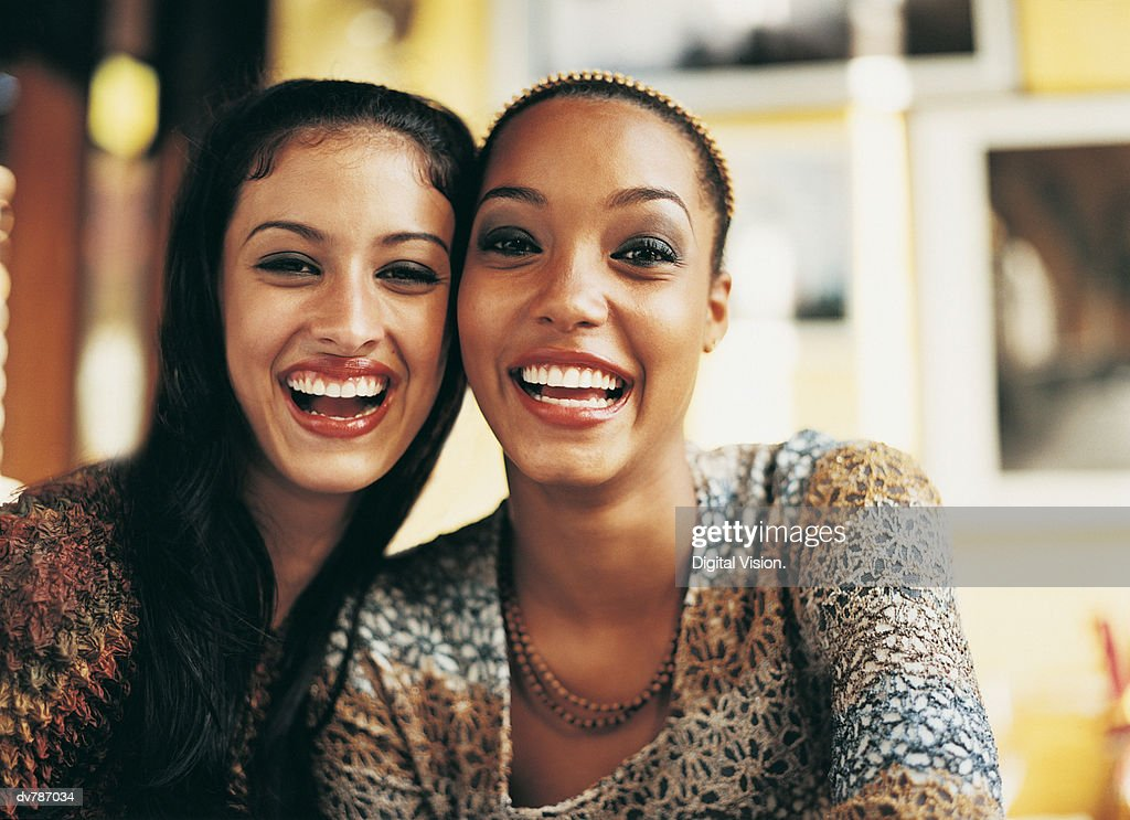 Portrait of Two Female Friends Smiling : Stock Photo