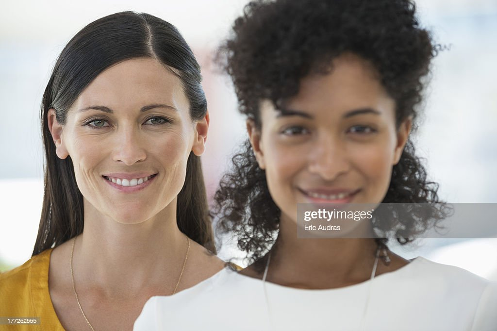 Portrait of two female friends smiling together : Stock Photo