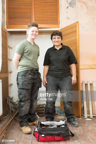 A portrait of two female plumbers on the site of a renovation they are working on.