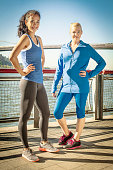 Portrait of two female runners on waterfront, New York City, USA