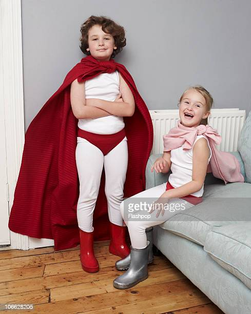 Portrait of two friends dressed as superheroes