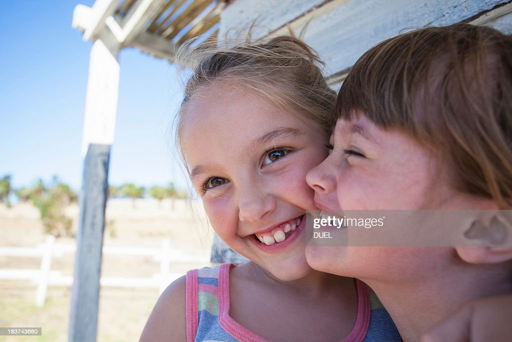Portrait of two girls cheek to cheek smiling : Stock Photo