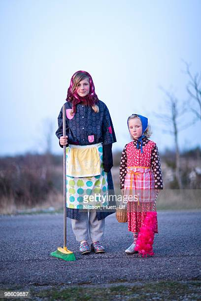 Portrait of two girls dressed up as Easter witches, Sweden.