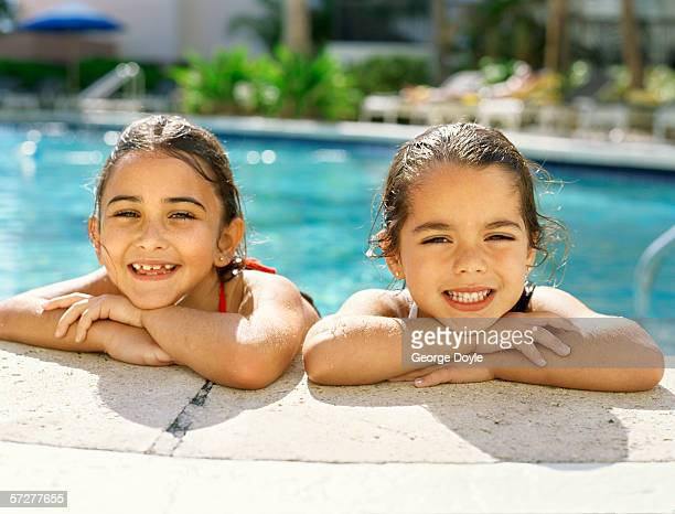Portrait of two girls in a  swimming pool