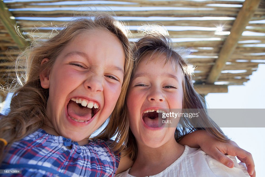 Portrait of two girls shouting : Stock Photo