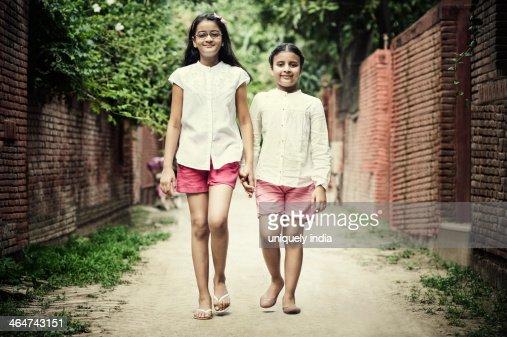 Portrait of two girls walking on the street