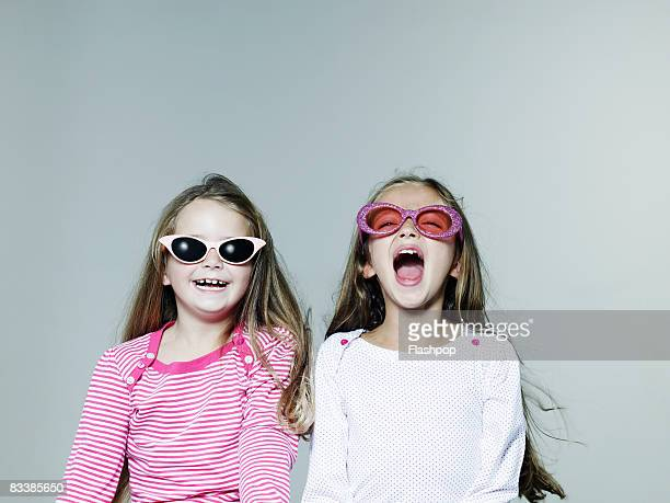 Portrait of two girls wearing sunglasses