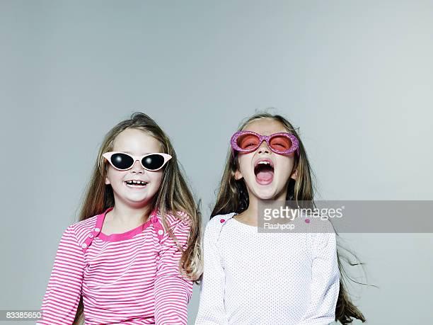 Portrait of two girls wearing sunglasses