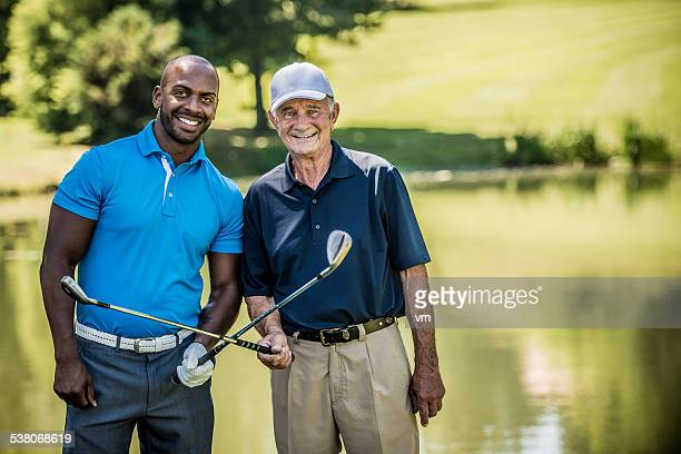 Portrait of Two Golf Players Crossing Their Golf Sticks