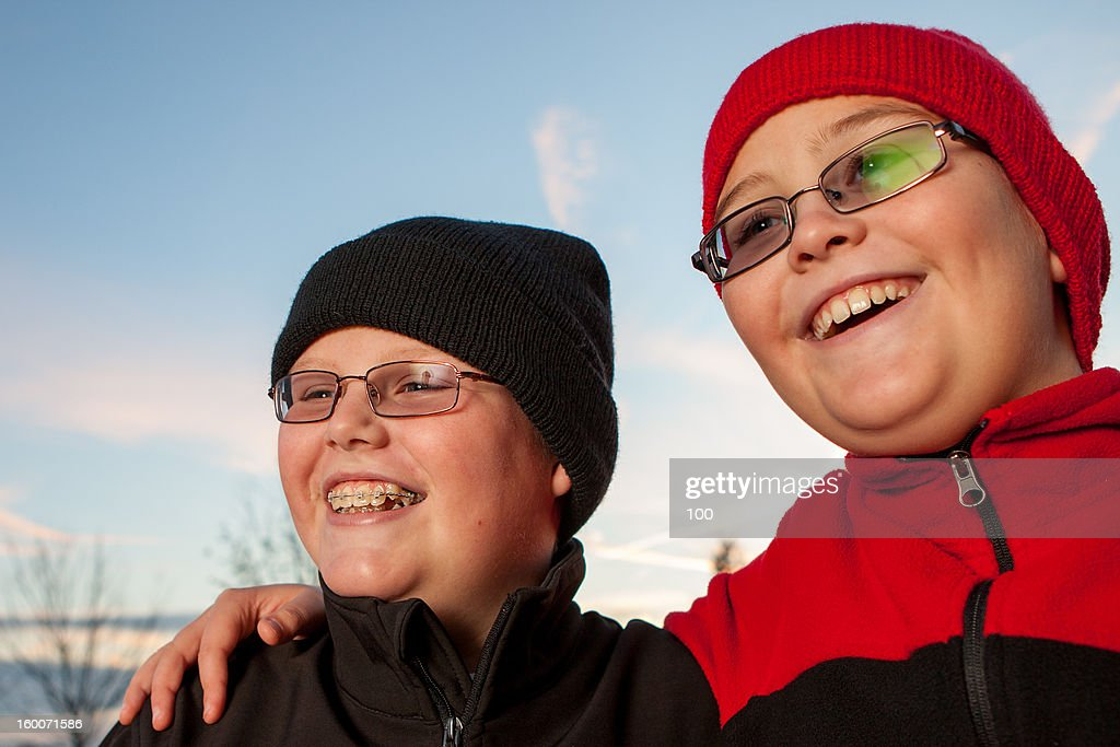Portrait of Two Happy Boys in the Winter : Stock Photo