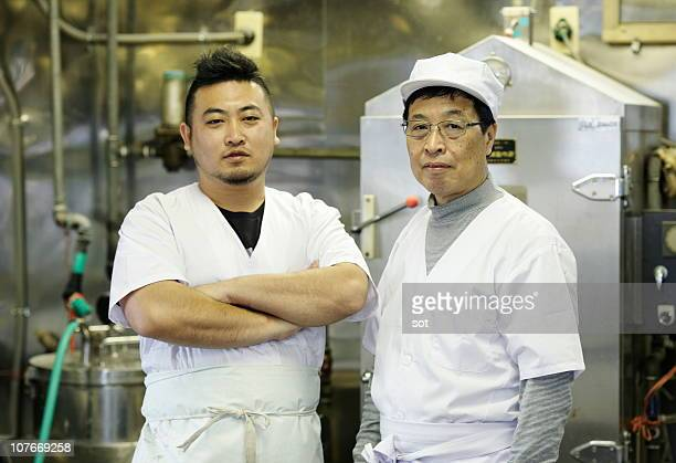 Portrait of two japanese sweet chefs in kitchen