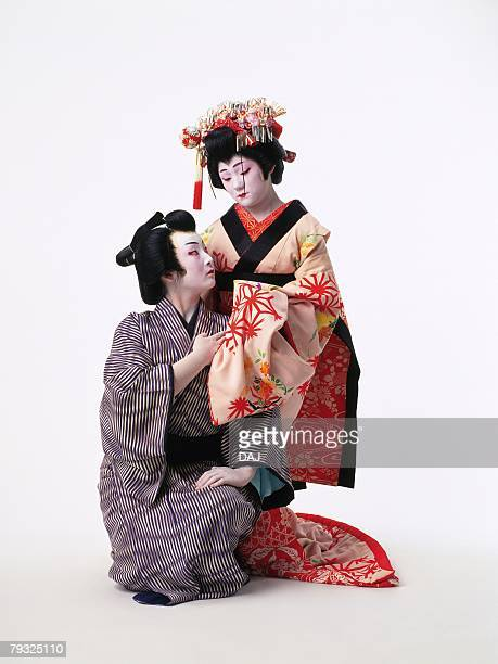 Portrait of two Kabuki actors, one acting as female, Front View