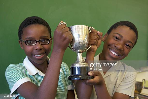 Portrait of two learners with their trophy, KwaZulu Natal Province, South Africa