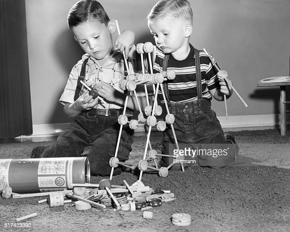 Portrait of two little boys playing with Tinker Toys Undated photograph