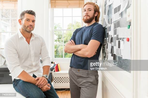 Portrait of two male designers in creative studio