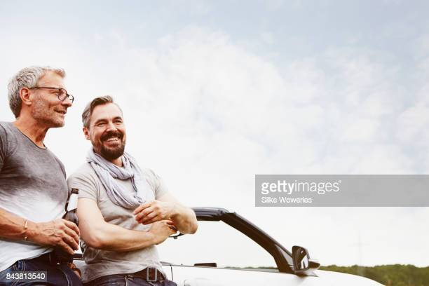 portrait of two mature adult men taking a break from driving
