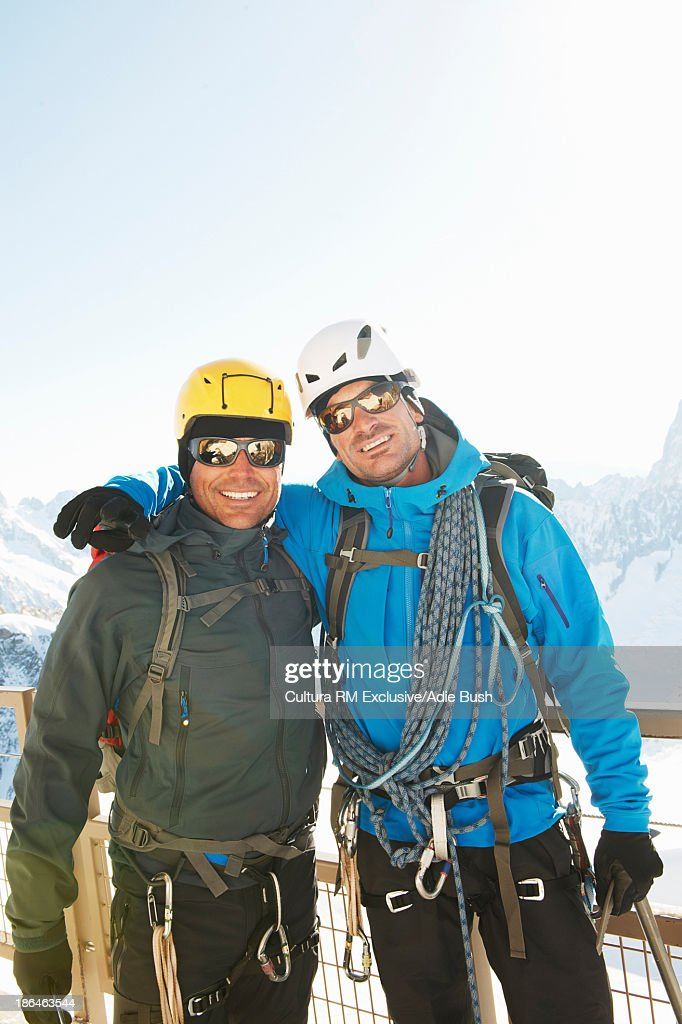 Portrait of two mountain climbers smiling : Stock Photo