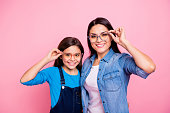 Portrait of two nice trendy cute winsome pretty lovely attractive charming cheerful cheery positive straight-haired girls touching glasses lifestyle isolated over pink pastel background