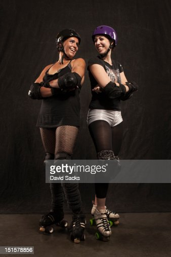 Portrait of two roller derby girls : Stock Photo