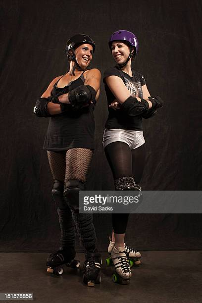Portrait of two roller derby girls