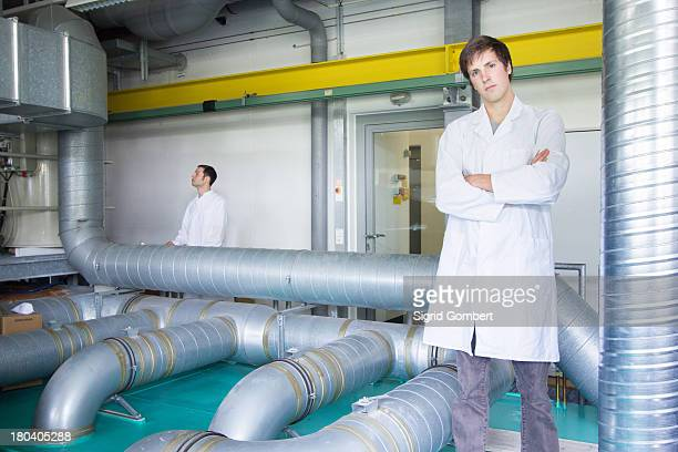 Portrait of two scientists in technical laboratory