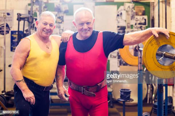 Portrait of two senior male powerlifters in gym