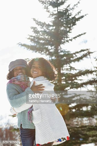 Portrait of two sisters (8-9,10-12) standing on snow : Stock Photo