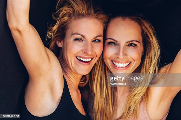 Portrait of two smiling blond women
