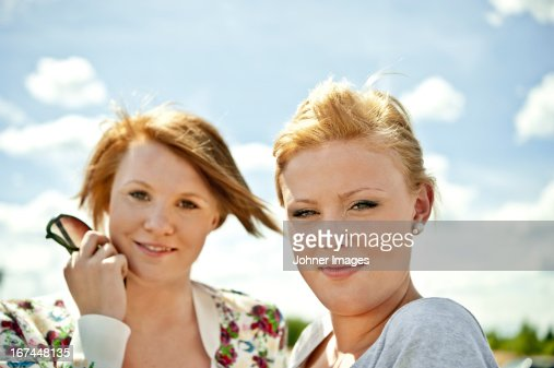 Portrait of two teenage girls smiling : Stock Photo