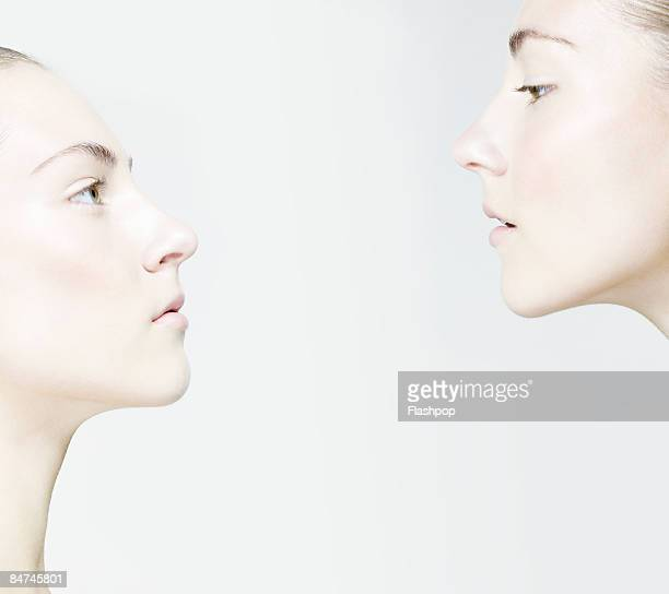 Portrait of two women facing each other