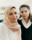 Portrait of Two Women, with One Wearing a Headscarf
