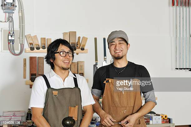Portrait of two young furniture craftsmen