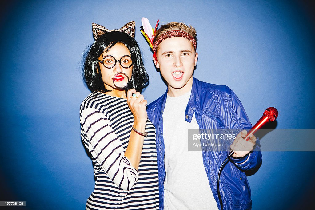 Portrait of two young people in fancy dress : Stock Photo