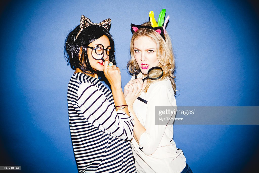Portrait of two young women in fancy dress : Stock Photo