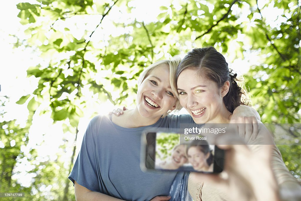 portrait of two young women taking their picture : Stock Photo