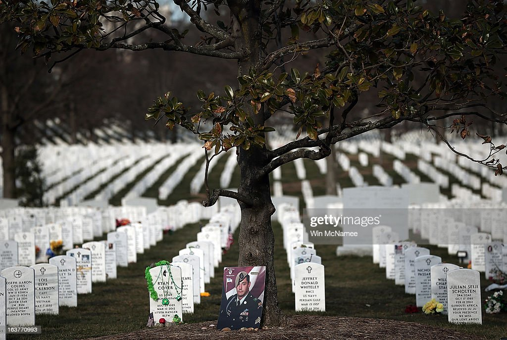 A portrait of U.S. Army Sgt. Alessandro L. Plutino rests against a tree in Section 60 at Arlington National Cemetery March 15, 2013 in Arlington, Virginia. Section 60 is the section of the cemetery where American military members killed in Iraq and Afghanistan are currently laid to rest, though soldiers and Marines from World War II through Afghanistan are also buried in the section. March 20th marks the ten-year anniversary of the beginning of the war in Iraq. U.S. Army Sgt. Alessandro L. Plutino served with the 1st Battalion, 75th Ranger Regiment, United States Army during Operation Enduring Freedom in Afghanistan, where he died.