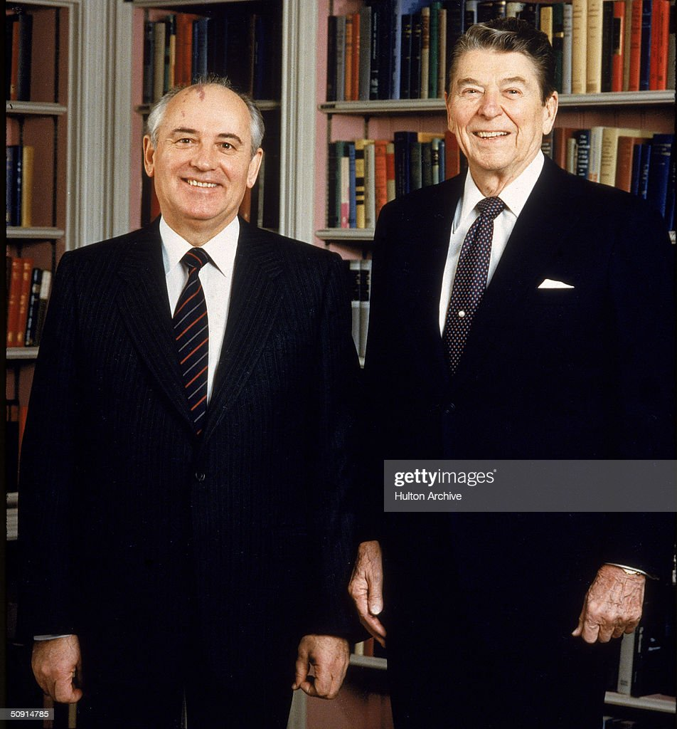 Portrait of US president Ronald Reagan posing with Soviet president Mikhail Gorbachev in the White House library Washington DC December 8 1987