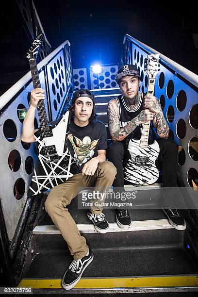 Portrait of Vic Fuentes and Tony Perry guitarists with American posthardcore group Pierce The Veil photographed before a live performance at the O2...