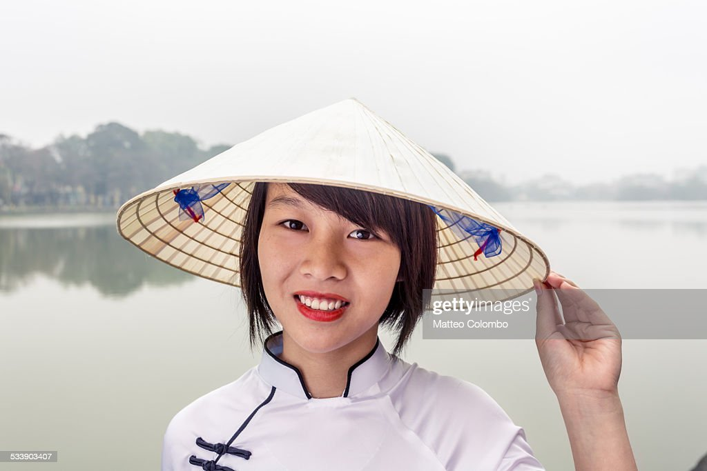 Portrait of vietnamese girl with conical hat