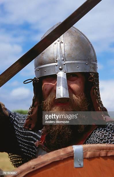Portrait of Viking in battle dress at Foteviken Viking Market, Hollviken, Skane, Sweden, Europe