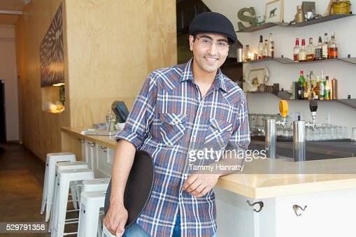 Portrait of waiter holding tray : Stock-Foto