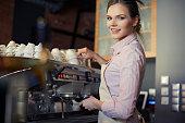 Portrait of waitress making coffee