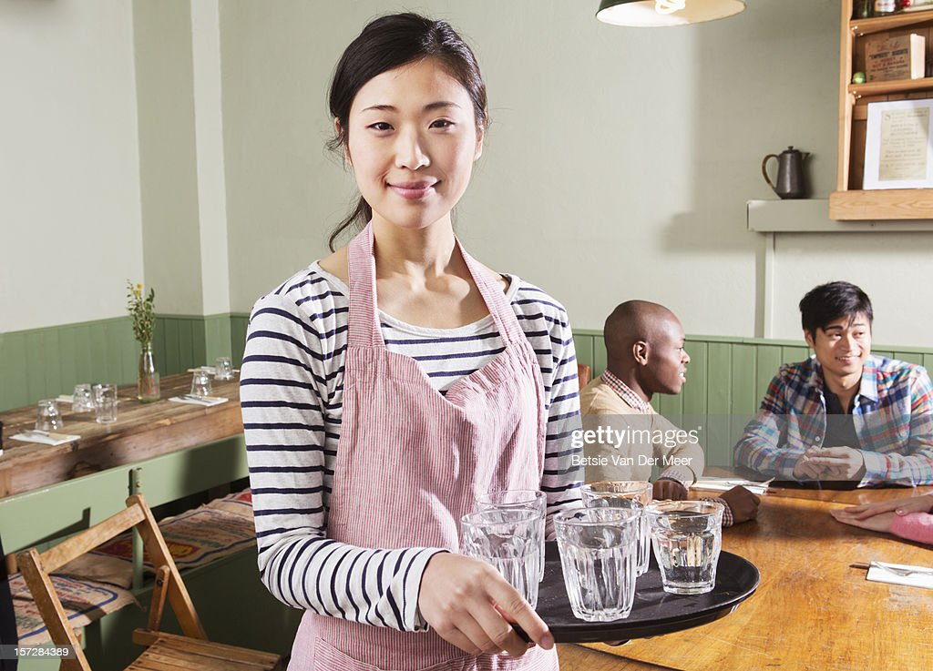 Portrait of waitress serving in restaurant. : Stock Photo