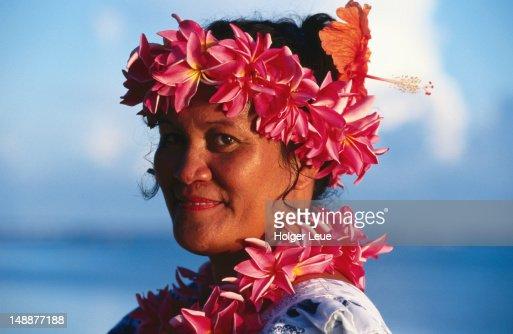 Portrait of waitress with flower leis, Aitutaki Lagoon Resort.