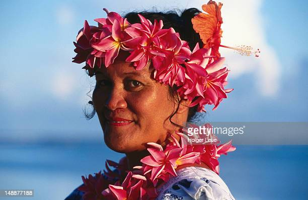 Portrait of waitress with flower leis, Aitutaki Lagoon Resort.