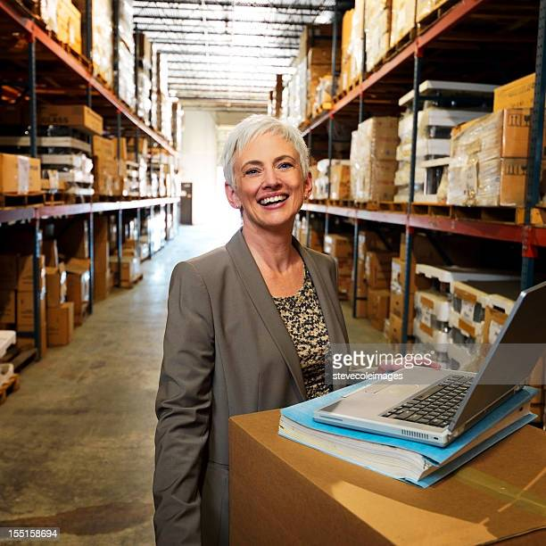 Portrait of Warehouse Businesswoman Smiling