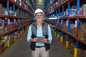 Portrait of warehouse worker using digital tablet in warehouse