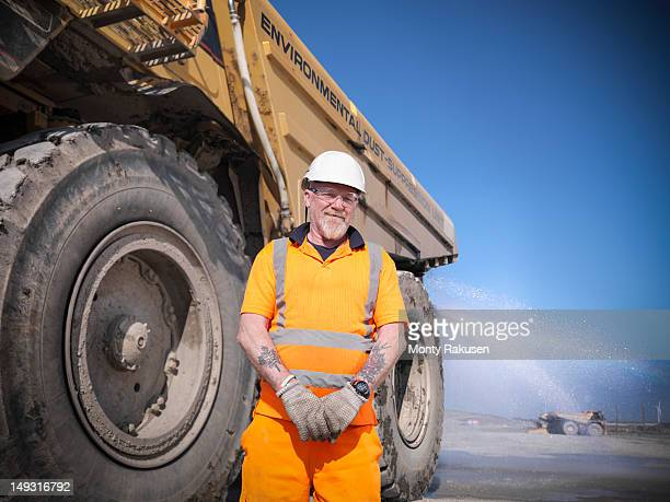 Portrait of water bowser driver in opencast coalmine