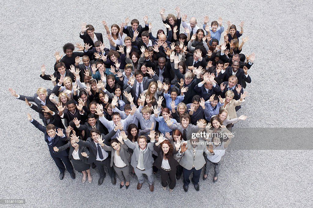 Portrait of waving business people
