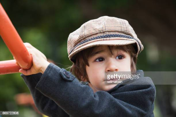 Portrait Of Well Dressed Little Boy In Outdoor.